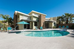 Midcentury Inspired Solar-Powered Executive Pool Home