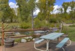 Picnic table on main deck of home at Durango Colorado waterfront vacation rental cabin river pond fly fishing canoe
