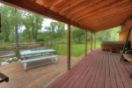 Durango Colorado waterfront vacation rental cabin river pond fly fishing canoe main deck w hot tub and outdoor dining