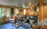 Living room and dining room in Durango Colorado waterfront vacation rental cabin river pond fly fishing canoe