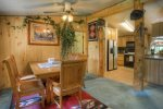 Durango Colorado waterfront vacation rental cabin river pond fly fishing canoe dining room and kitchen