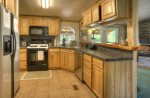 Modern kitchen in Durango Colorado waterfront vacation rental cabin river pond fly fishing canoe Hesperus CO