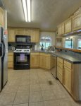 Modern kitchen in Durango Colorado waterfront vacation rental cabin river pond fly fishing canoe