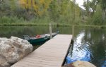 Durango Colorado waterfront vacation rental cabin river pond fly fishing canoe dock and canoe at pond
