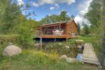 Rear of home from island at Durango Colorado waterfront vacation rental cabin river pond fly fishing canoe Hesperus CO