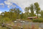 Durango Colorado waterfront vacation rental cabin river pond fly fishing canoe Hesperus CO rear of home from across La Plata River
