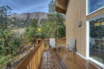 Panoramic mountain views from deck off living room at Durango Colorado vacation rental home known as Cliff View House