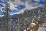 Snow coverd wodos and mountains at Durango Colorado vacation rental home known as Cliff View House