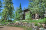 Front of house in summer forest at Durango Colorado vacation rental mountain home near Purgatory Resort known as Eagles Nest