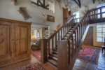 Durango Colorado vacation rental mountain home near Purgatory Resort known as Eagles Nest foyer hall stairs to upper level