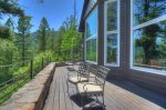 Deck w forest and mountain views at Durango Colorado vacation rental home near Purgatory Resort known as Eagles Nest