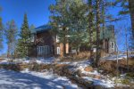 Durango Colorado vacation rental mountain home near Purgatory Resort known as Eagles Nest front of alpine cabin in summer