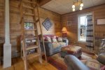 Living room w antique wood stove in Durango Hesperus Colorado vacation rental Cranberry Cottage Riverside Cabin