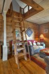 Living room w country decor at Durango Hesperus Colorado vacation rental Cranberry Cottage Riverside Cabin