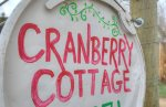 Sign at gated entrance of Durango Hesperus Colorado vacation rental Cranberry Cottage Riverside Cabin