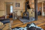 Den w fireplace at Durango Hesperus Colorado vacation rental Cranberry Cottage Riverside Cabin