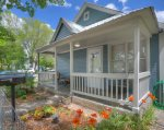 Garden and covered porch at Downtown Cottage vacation rental home in Durango Colorado