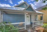 Covered porch at Downtown Cottage vacation rental home in Durango Colorado