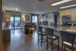 Living room balcony and mountain views at Durango Colorado vacation rental condo at Purgatory Resort hot tub pool gym