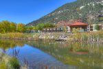 Pond and gazebo in private park of Durango Colorado vacation rental