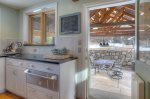 Kitchen in outdoor dining pavillion at Durango Rock House vacation rental home cabin Colorado