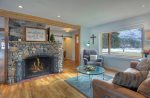 Original rock fireplace in living room of Durango Rock House vacation rental home cabin Colorado
