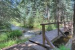 Bridge to fishing island at Creekside Retreat vacation rental home in Durango Colorado