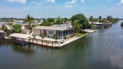 GORGEOUS 3/2 ON WATER HOME WITH A BOAT LIFT!