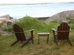 adirondack chair at fire pit with open ocean view