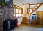 Downstairs in the daylight basement you will find a bright livingroom with a gas stove.
