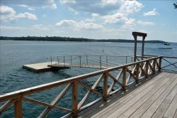 Relax in the serenity of this accommodating waterfront home.