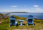 Enjoy the view from a pair of adirondack chairs in front of the cottage.