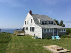 Turn-of-the-century classic Maine cottage with sweeping southeasterly views towards Halfway Rock Light.