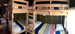 A second bedroom in the main cabin has two sets of twin bunk beds