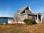 This sweet cottage perched along Harpswell Sound offers panoramic views and stellar sunsets