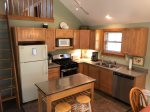 Kitchen with Full Fridge, Microwave, Dishwasher, Oven & Stove and Coffee Pot