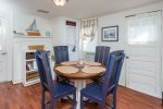Comfortable Dining Area that also features a super convenient full size Washer & Dryer.