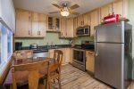 Lovely kitchen features warm wood & stainless appliances.
