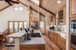 Lovely Granite Countertops and Knotty Pine ceilings are equisite.