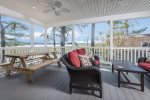 This perfect Porch has a Picnic Table for Crab Feasts and dining Al Fresco.
