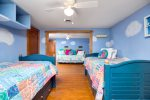 The kids will love this double room with ocean and cloud mural.