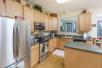 Gorgeous Kitchen with Stainless Appliances overlooks 2nd Living Area.