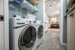 Convenient Laundry Area is just off of the Kitchen and has high-end appliances.