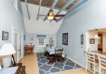 Soaring Ceilings and Exposed Beams add to the island charm of this Home.