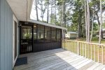 Screened-in Porch and Large Deck with Charcoal Grill overlooks lovely backyard.
