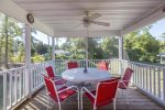 Just off the Kitchen is the Screened-in Porch for dining Al Fresco.