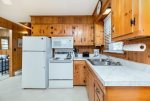 Knotty Pine Cabinetry adds to the charm of this well-cared for Vacation Home.