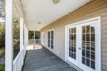 Front Porch is furnished with Country Rocking Chairs & comfortable Wicker Furniture.
