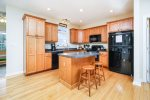 Well-equipped Kitchen with Breakfast Bar will delight the Chef in your Family.