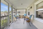 Lovely Front Screened Porch is a great place to share stories at the day`s end.